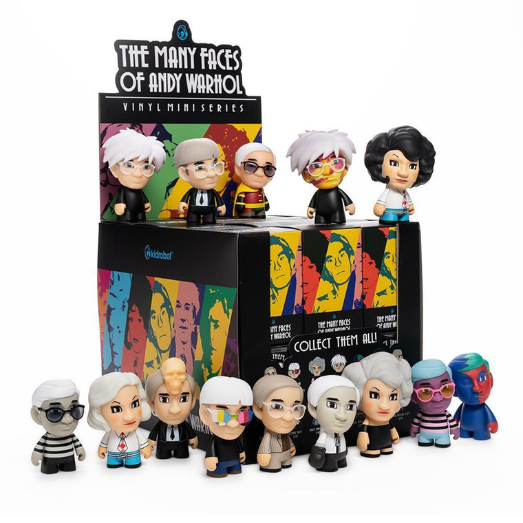 A stack of black boxes and Warhol figurines