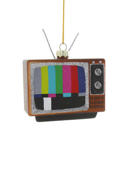 An ornament in the shape of an old tv, with colored stripe test screen.