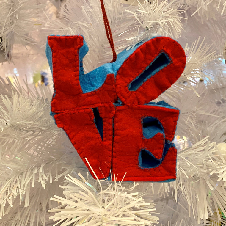 """A soft ornament of red and blue stacked letters that spell """"LOVE"""""""