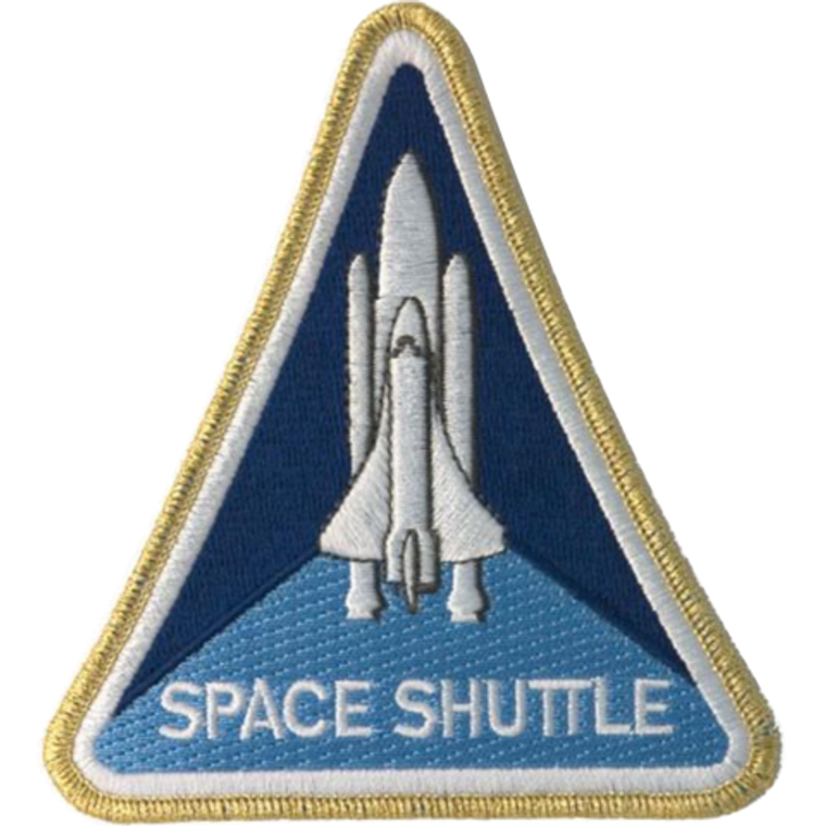 This image shows a white space shuttle  on a 2 tone blue background.  It is triangular and is outlined in gold thread.