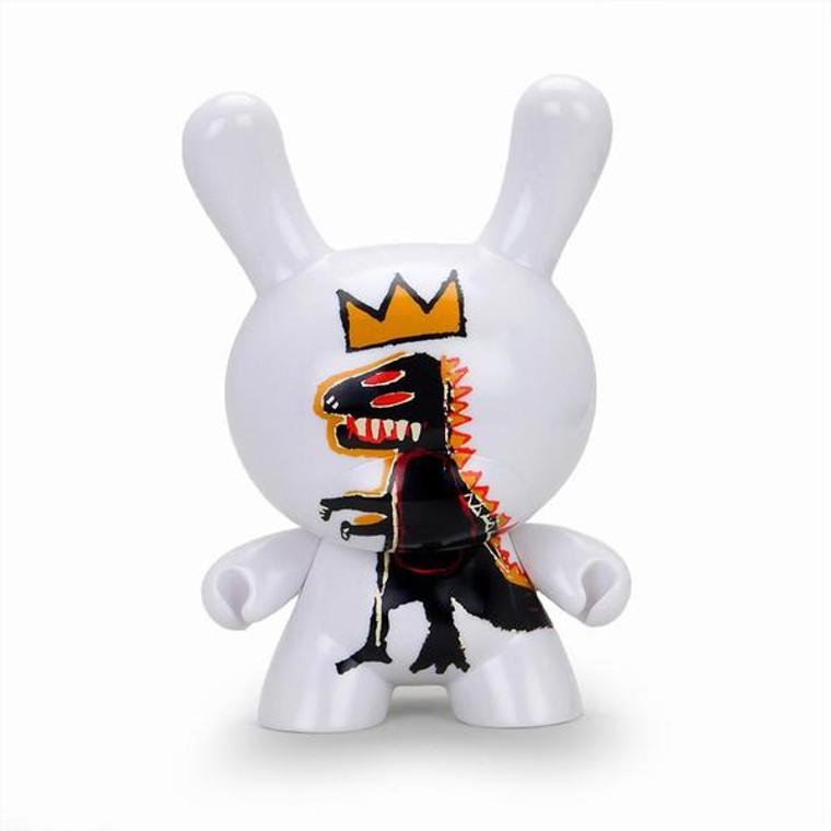 A white vinyl rabbit toy with a Basquiat Pez Dispenser art work.