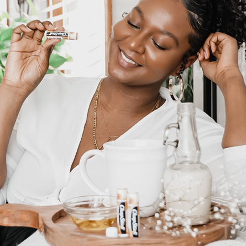 Young woman applying ChapStick® Clover Honey.
