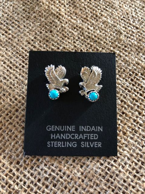Eagle in Flight. Handmade sterling silver,eagle landing on Turquoise stone. Navajo silversmith,Isabelle Yazzie.