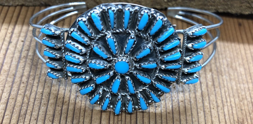 "Sterling Silver cluster cuff with several stabalized turquoise needlepoint stones.  Top measures approximately 1 7/8"" long by 2 3/4"" wide including stones on side.  Navajo silversmith: Rosemary Tom Nez"