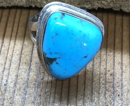 Beautiful  Triangle shaped Turquoise Ring. Point to point is close to 2cm.Depth is .7 cm. Very simple double band.
