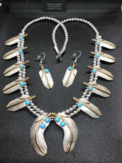 Sterling Silver Navajo Feather Set with Turquoise n Gold Overlay down the Centre seam.