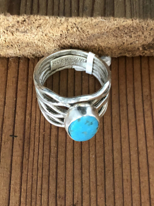 Woven Sterling Silver Band with Oval Turquoise Stone.