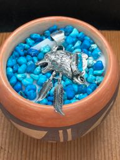 Sleeping Beauty Turquoise in Wolf Head with 2 Dangling Feathers