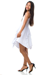 This is an all over white dress with thicker straps, double lined, and has a full hanky hem skirt, with ruffle detailing.