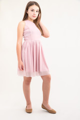 Tween Girls Pink Glitter One-Shoulder Skater Dress in Longer Length side view with ballet flat.