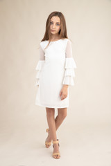 Tween Girls Ivory Fitted Bell Sleeve Dress in Longer Length.