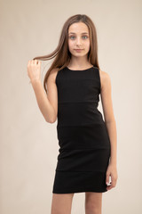 Tween Girls Black Fitted Texture Panel Dress in Longer Length close.