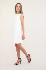 Tween Girls Ivory Boat Neck Dress in Longer Length.