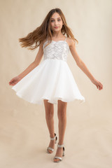 Tween Girls Ivory and Silver Chiffon Dress with Sequins in Longer Length twirling.