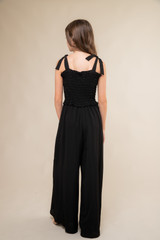 Black Smocked Jumpsuit with Knotted Straps back.