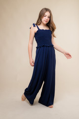 Navy Smocked Jumpsuit with Knotted Straps.