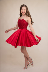 Red Sequin and Satin Hank Hem Party Dress.