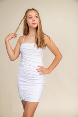 White Ruched Spaghetti Strap Dress in Longer Length.