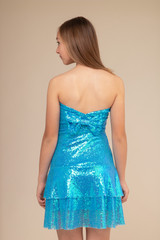 Turquoise Sequin Bow Back Dress.