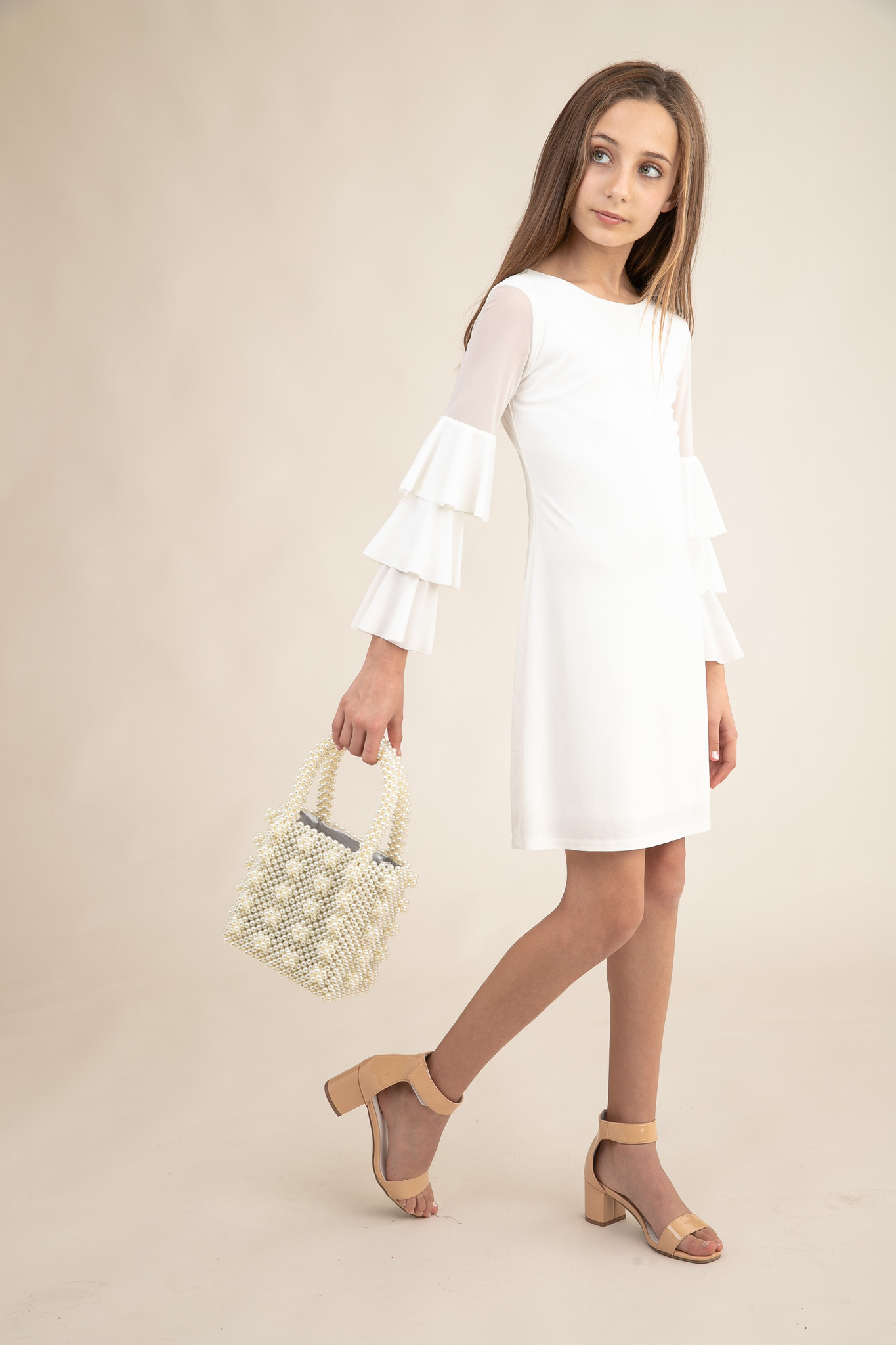 Tween Girls Ivory Fitted Bell Sleeve Dress in Longer Length with shrimps bag.