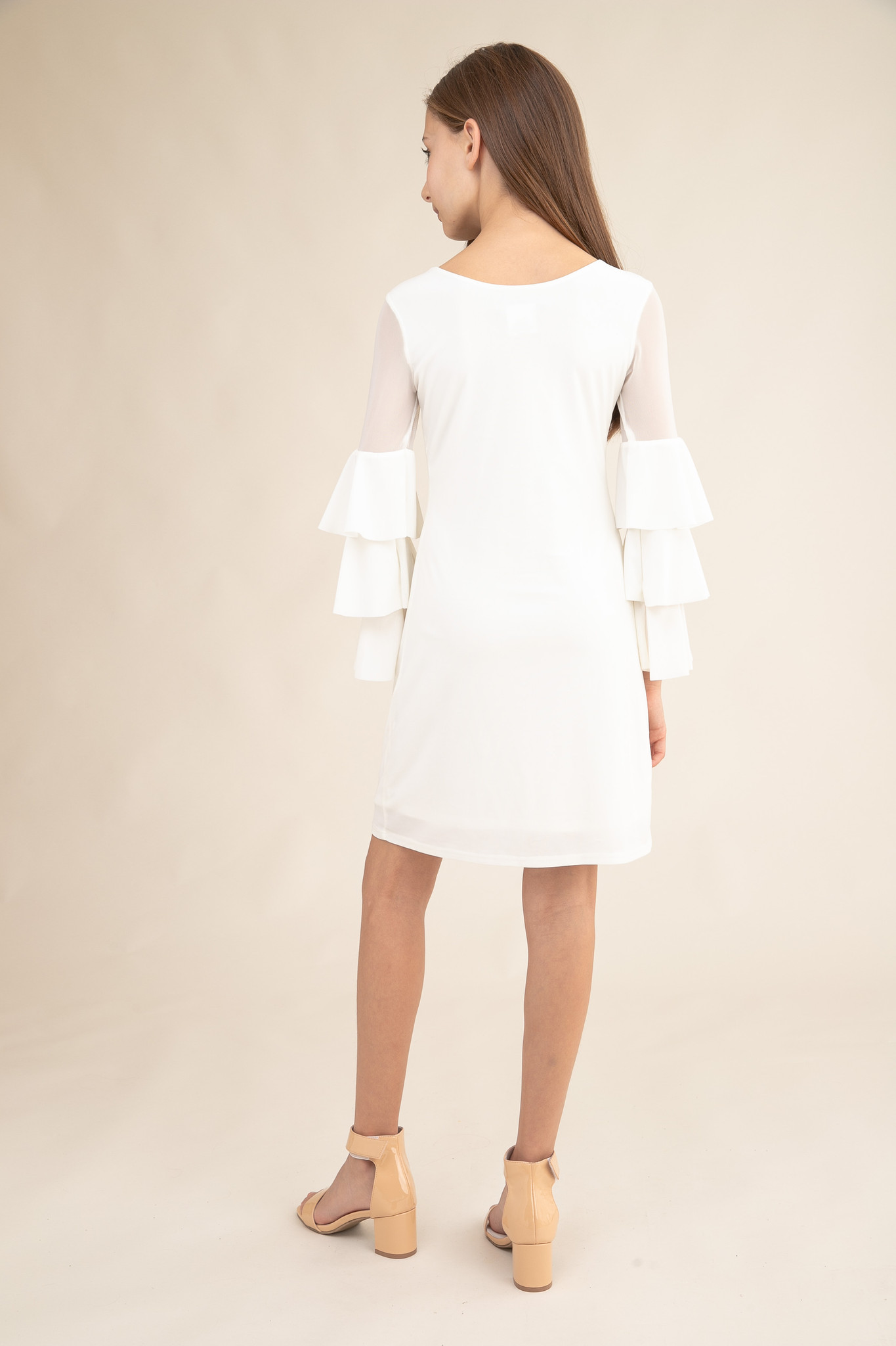 Tween Girls Ivory Fitted Bell Sleeve Dress in Longer Length back view.