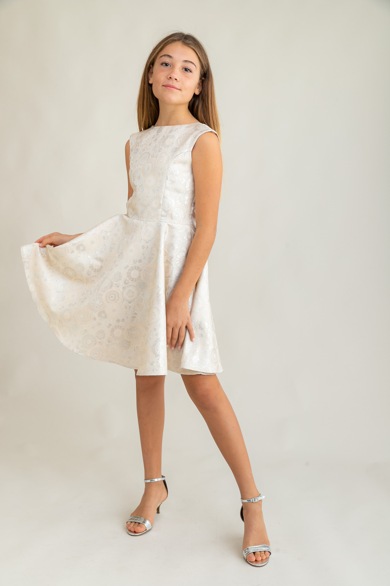 Tween Girls Ivory and Silver Cap Sleeve Dress in Longer Length full length shot.