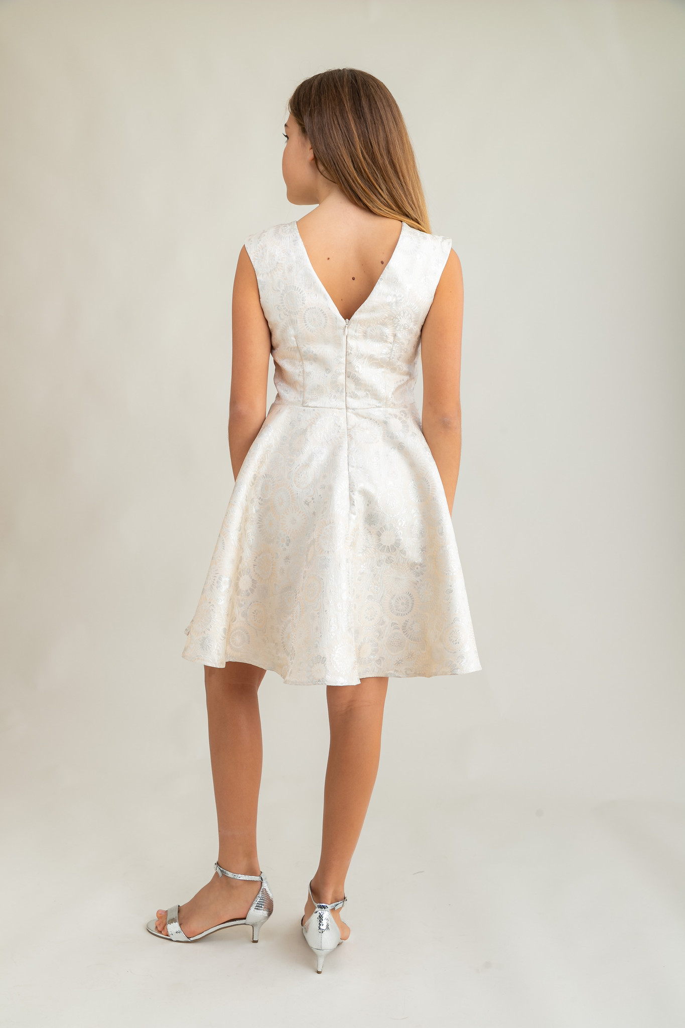 Tween Girls Ivory and Silver Cap Sleeve Dress in Longer Length back view.