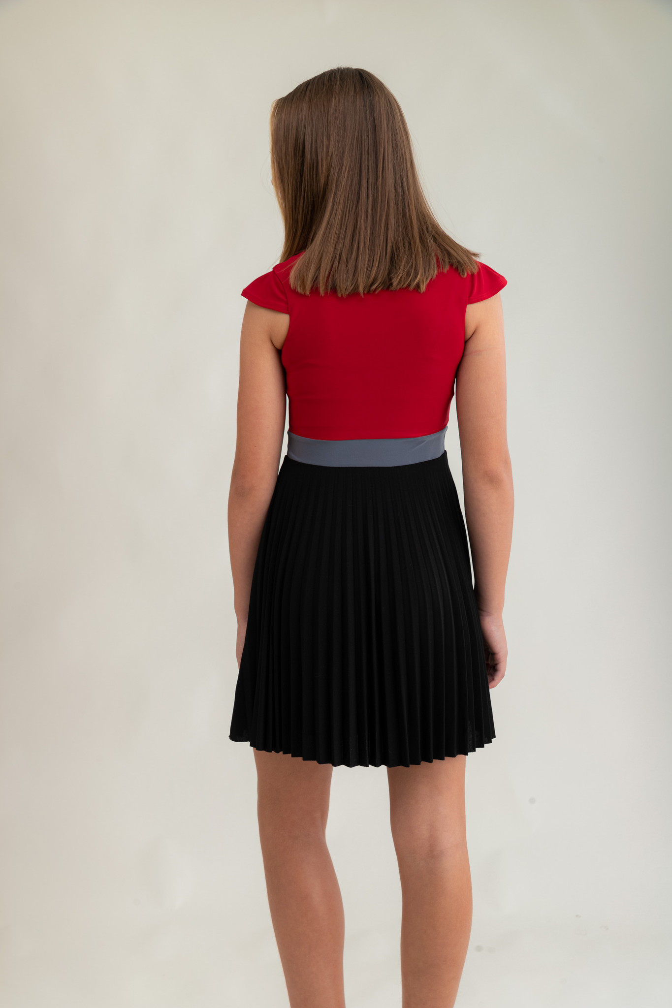 Tween Girls Pleated Red Color-Block Dress with Cap Sleeve back view.