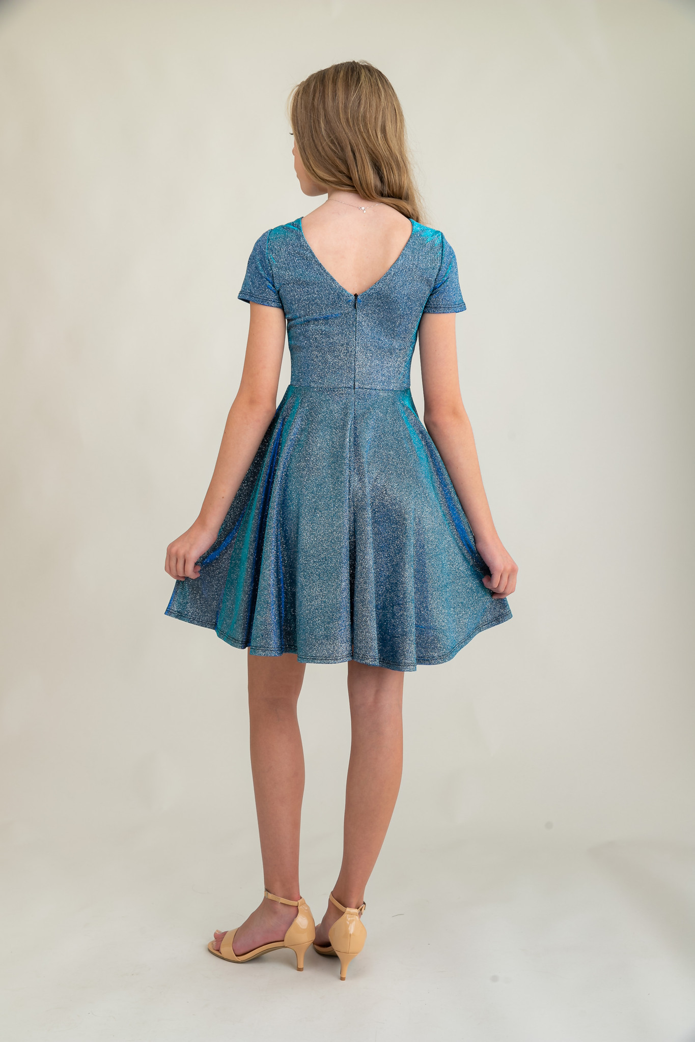 Tween Girls Blue Glitter Short Sleeve Dress in Longer Length back.