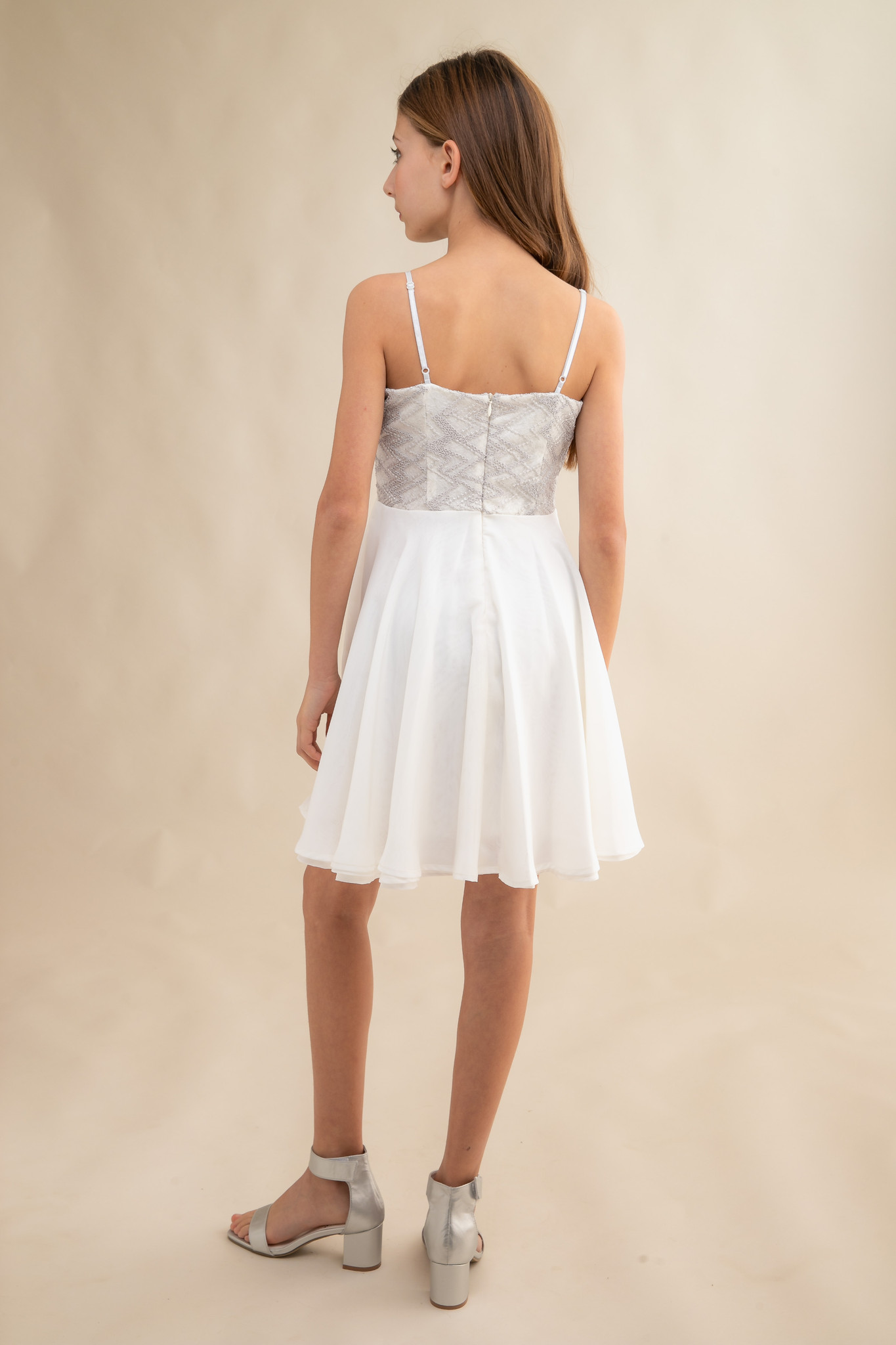 Tween Girls Ivory and Silver Chiffon Dress with Sequins in Longer Length back view.