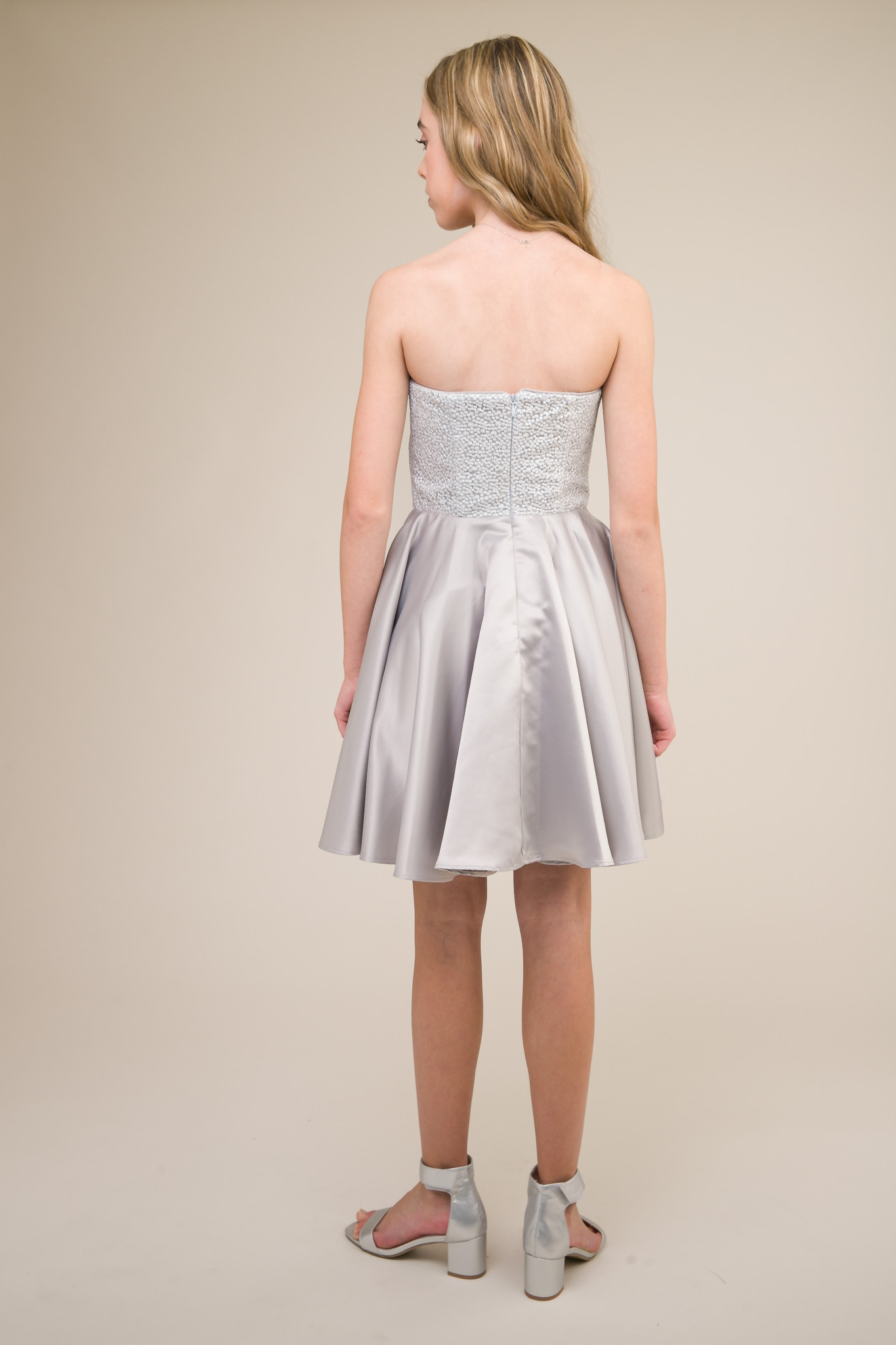 Junior Girls Silver Sequin and Satin Party Dress back.