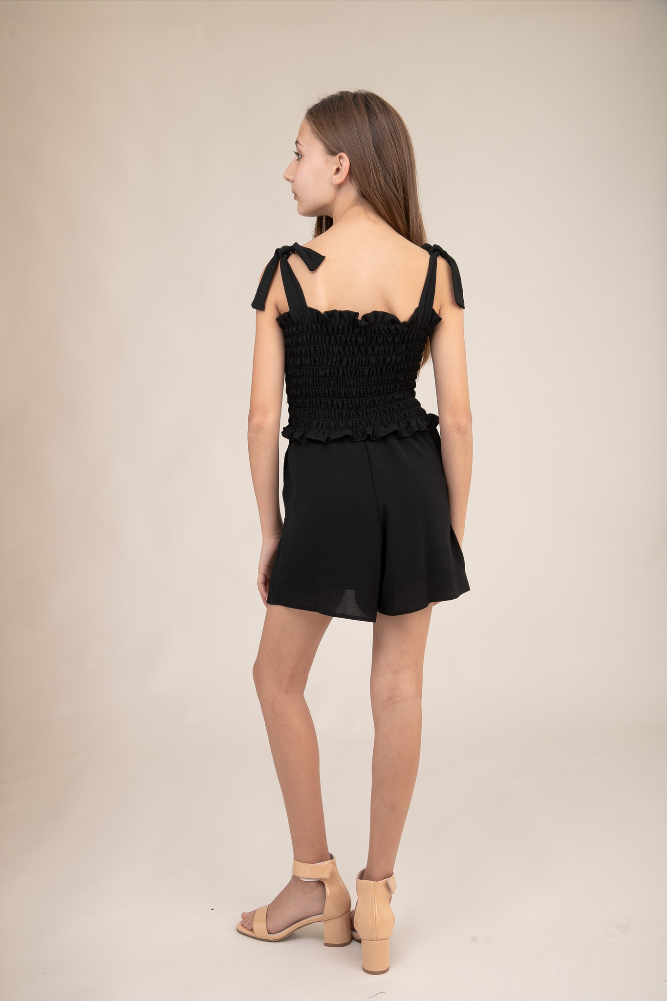 Black Smocked Romper with Knotted Straps back.