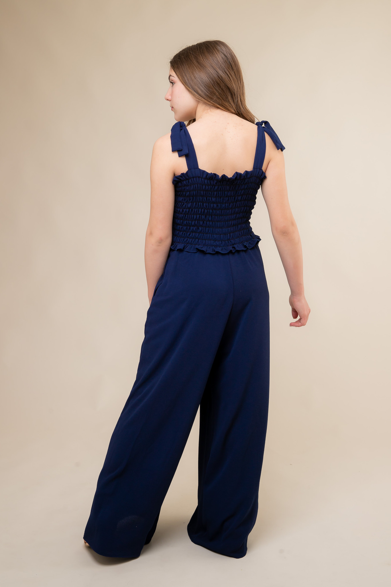 Navy Smocked Jumpsuit with Knotted Straps back.