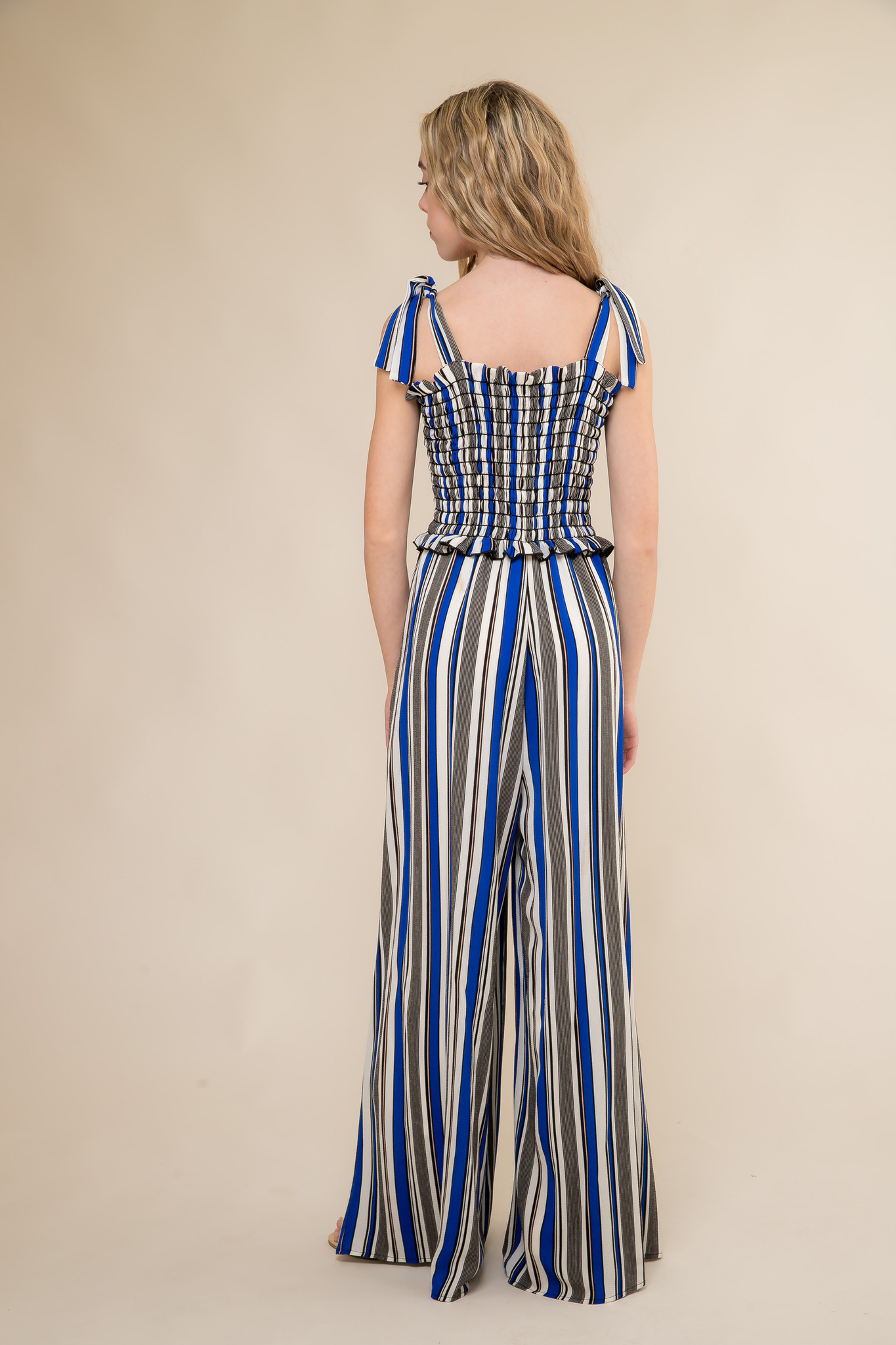 Stripe Smocked Jumpsuit with Knotted Straps back.