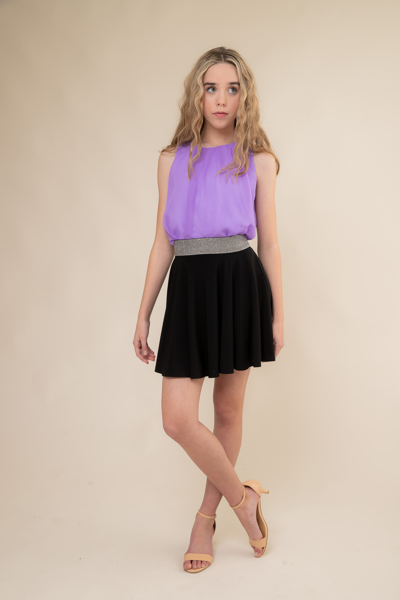 Lilac Top and Black Skater Skirt with Belt.