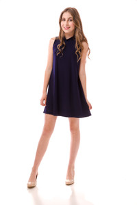 Full length photo of the all over stretch Tween Girls High Neck Navy A Line Dress.