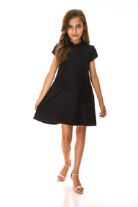 Twirl in the Tween Girls Cold Shoulder A Line Dress in Black Eyelet made in a very stretchy fabric.