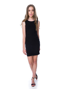 In motion shot of the Tween Girls Black Ruched Fitted Dress in Longer Length.