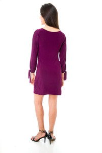 Back view of the Tween Girls Long Sleeve Dress with Knot Detail in Plum.
