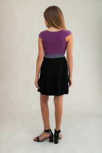 Tween Girls Pleated Pale Plum Color-Block Dress with Cap Sleeve back view.