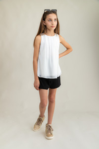 Chiffon A Line Top in White tucked out.