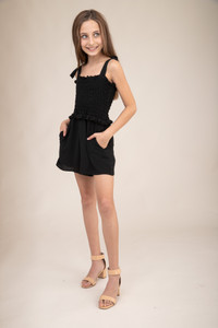 Black Smocked Romper with Knotted Straps.