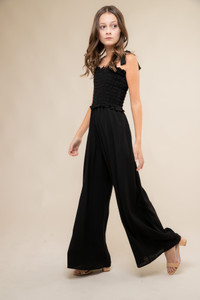 Black Smocked Jumpsuit with Knotted Straps.