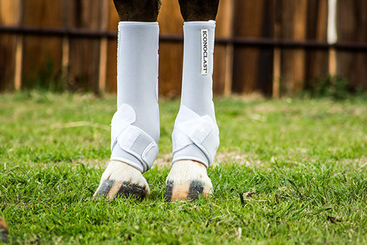 """Performance horses need extra support because they are exposed to difficult maneuvers such as hard stops, backing, deep turns, jumps, and long, full strides. As a result of performing these maneuvers the hock reaches a fully flexed position and a """"vertical load"""" force is applied to the hock joints and the soft tissue of the lower limbs. Since the suspensory ligament attaches at the top of the cannon bone, just below the lower hock joints, it can become stressed or injured due to these forces from above."""