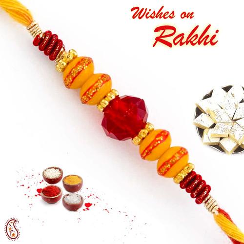 Aapno Rajasthan Red Crystal Stone & Deep Yellow Beads Studded Thread Rakhi