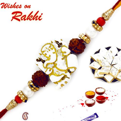 Aapno Rajasthan White & Golden Beads Ganesh Motif Rakhi