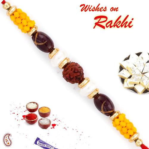 Aapno Rajasthan Lovely Yellow Beads Studded Rudraksh Rakhi