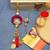 Red Loop Flower design Bhaiya Bhabhi Rakhi Set with Pearl Hangings