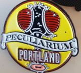 Enamel pin with the official logo of The Peculiarium with art by Mike Wellins.
