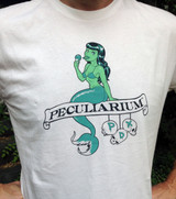 100% cotton tee with Colin Batty's mermaid eating an ice cream cone design.